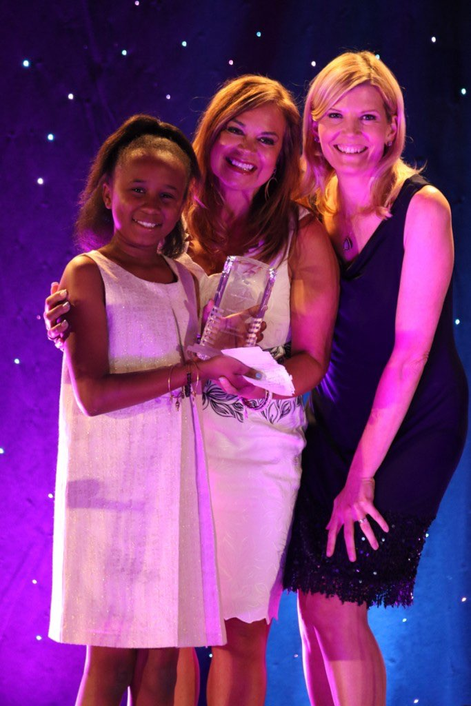 NBC Correspondent Kate Snow presenting the Big Brothers Big Sisters President's Award to CLO Renee Olson and her Little Sister Ryan in 2015. Photo courtesy of Nerium International.